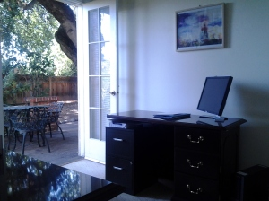 Volunteer Desk and patio - if you volunteer in the office, you will even get coffee breaks on our lovely patio!